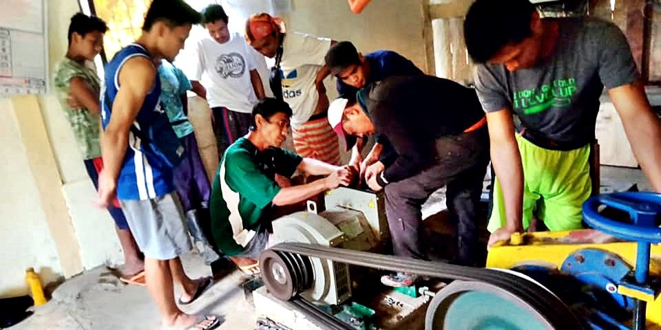 Locals help in the installation of the new generator for the SIBAT Micro-Hydro Power project in Malibcong, Abra.