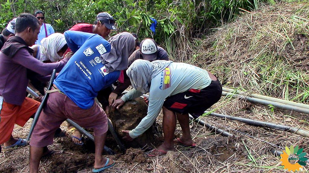 Pintakasi or Bayanihan system of the community.